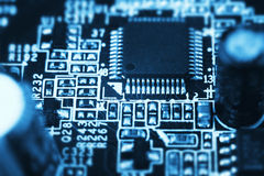 Microchip on a computer board Royalty Free Stock Photography