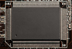 Microchip- eller microcircuitchip Fotografering för Bildbyråer