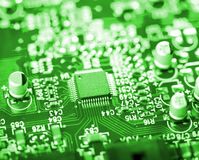 Microchip on green circuit board Stock Photo