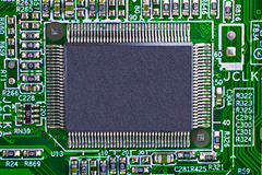 Microchip. Green electronic circuit board with processor Stock Photo