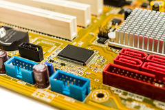 Microchip on motherboard Royalty Free Stock Photography