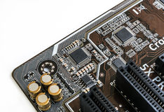 Microchip on the motherboard in isolated background Royalty Free Stock Photo