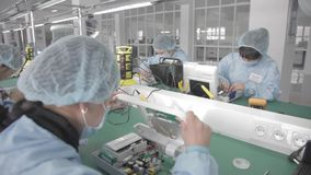 Microchip production factory. Technological process. Assembling the board. Chip. Professional. Technician. Computer stock footage
