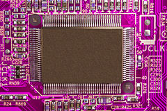 Microchip. Purple electronic circuit board with processor Royalty Free Stock Image
