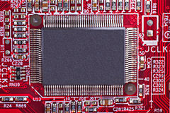 Microchip. Red electronic circuit board with processor Royalty Free Stock Images