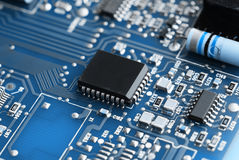 Microchips on a circuit board. Royalty Free Stock Photography