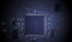 Microchips on a circuit board. Stock Photos