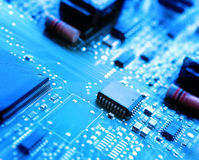 Microchips on a circuit board Stock Photo