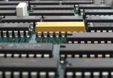 Microchips on electronic board. Sheet and bonding details on electronic card.fragment Stock Images
