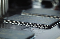 Microcircuit on the printed-circuit board close up Stock Photography