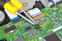 Microcircuit and screwdriver Stock Photo