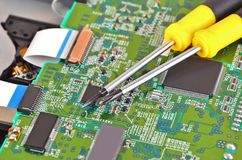 Microcircuit and screwdriver Stock Photos