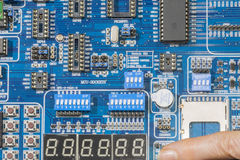 Microcontroller board. A person presses the switch the  a  Microcontroller Development board Stock Photo