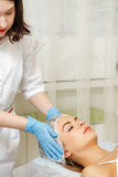 Microcurrent therapy. Hardware cosmetology. Stock Photography