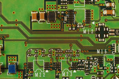 Microelectronic circuit board with components from modern device close up. Stock Images