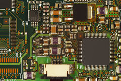 Microelectronic circuit board with microchips closeup. Royalty Free Stock Photo