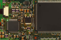 Microelectronic circuit board from modern device close up. Royalty Free Stock Photos