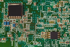 Microelectronic circuit with digital components board closeup. Stock Photos
