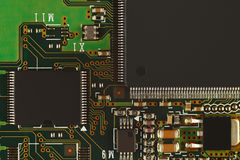 Microelectronic circuit with digital microchips board closeup. Stock Photography