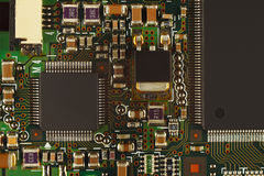 Microelectronic circuit with microchips board from digital device close up. Royalty Free Stock Images