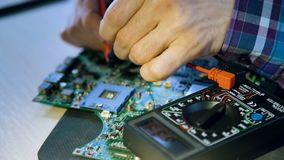 Microelectronics computer engineer motherboard. Computer hardware development. microelectronics technology science concept. engineer testing electric current in stock video footage