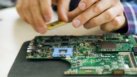 Microelectronics courses cpu motherboard socket. Microelectronics workshop courses. computer repair. technician removing cpu from motherboard socket stock video