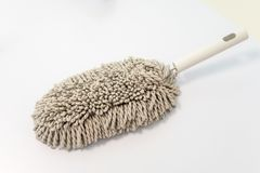 Microfiber brush duster with white handle for cleaning isolated stock photos