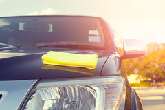 Microfiber car shine. Microfiber cloth on surface of car shine Royalty Free Stock Photos