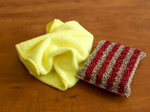 Microfiber cleaning cloth and metallic colored kitchen sponge Royalty Free Stock Photography