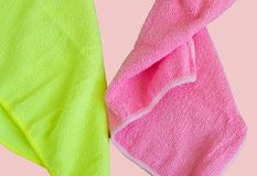 Microfiber cloths isolated on pink background, tools for cleaning and cleanliness. The concept of spring cleaning, flat lay.  stock images