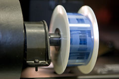 Microfilm on reader spool. A roll of microfilm mounted on the spool of the film reader Royalty Free Stock Photo
