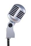 Microfone cinzento do vintage em um fundo branco Fotografia de Stock Royalty Free