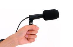 Microfone com mão Fotografia de Stock Royalty Free