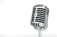 Microfone de prata do vintage no fundo branco Fotografia de Stock Royalty Free