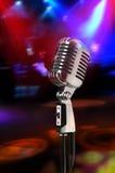 Microfone do vintage com luzes Fotografia de Stock Royalty Free