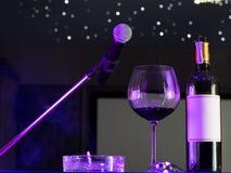 Microfone e um vidro do vinho Imagens de Stock Royalty Free