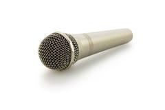 Microfone em um fundo branco Foto de Stock Royalty Free