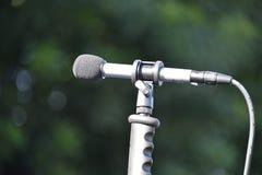 Microfone esquerdo exterior do revestimento Imagens de Stock