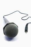 Microfone isolado com plugue Fotografia de Stock