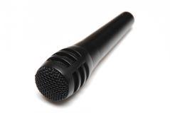 Microfone preto isolado Fotografia de Stock