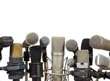 Microfones da reunião da conferência no fundo branco Imagens de Stock Royalty Free
