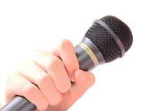 Microfono della holding della mano Immagini Stock