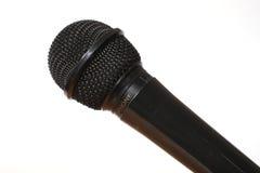 Microfono su priorità bassa bianca immagini stock
