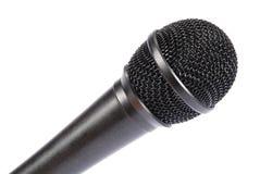 Microfoon die op witte achtergrond wordt geïsoleerde Stock Foto's