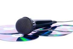 Microfoon en CDs Stock Afbeeldingen