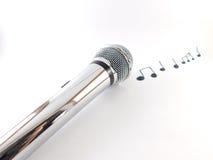 Microfoon met muzieknoten stock fotografie