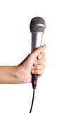 Microfoon op witte baground wordt geïsoleerd die Stock Afbeeldingen