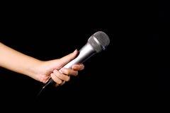 Microfoon op zwarte baground wordt geïsoleerd die Royalty-vrije Stock Afbeelding