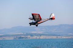 Microlight Pilot Low Flying Water Stock Image