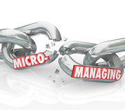 Micromanaging Words Breaking Chain Stopping Bad Management. Micromanaging word breaking apart on chain links to illustrate stopping bad management techniques of Stock Photo
